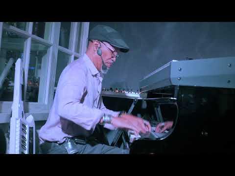 "Bob Baldwin performing ""Love Light In Flight"""