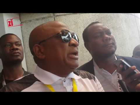Phillip Chiyangwa talks to the media upon his arrival at Harare Intl Airport.