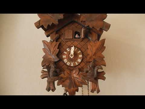Black Forest German Cuckoo Clock With Bird, Leaves, Squirrels and Music