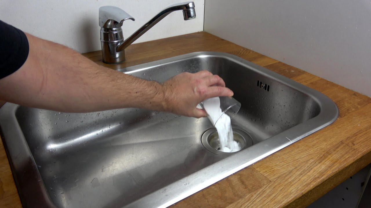 How to clear a clogged drain using baking soda and vinegar - YouTube