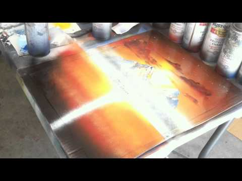 spray painting sunset mountains