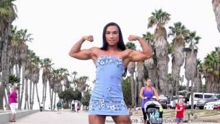 Tram Nguyen flexing in Hawaiian mini dress
