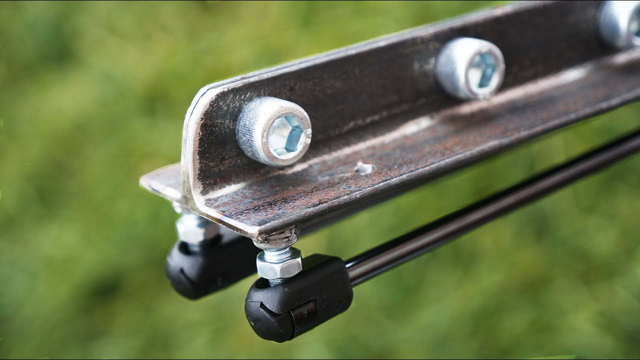 Cool idea! You only need a metal corner and a gas shock absorber!