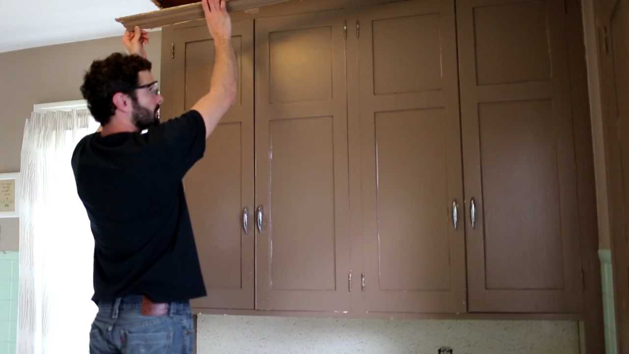 Removing crown molding from kitchen cabinets -