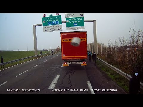 Footage appears to show migrants attacking truck at Calais border