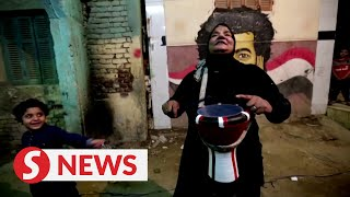 Cairo's female drummer takes up late brother's baton