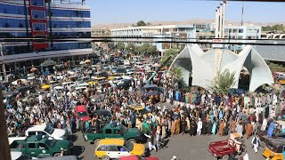 Taliban hang bodies throughout city