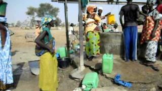 Drawing water in Senegal.