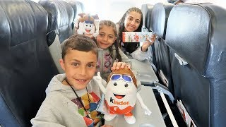 Kids Open Chocolate Kinder Surprise Eggs On A Plane! Family Fun Vlog