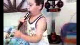 Elijah tries to play clarinet