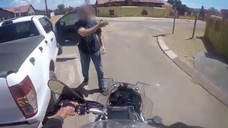 NO FEAR South African Police officer on bike chasing thugs.