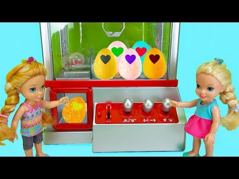 Elsa and Anna toddlers win Hatchimals from the claw machine