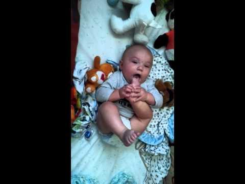 Cute Baby chews on foot