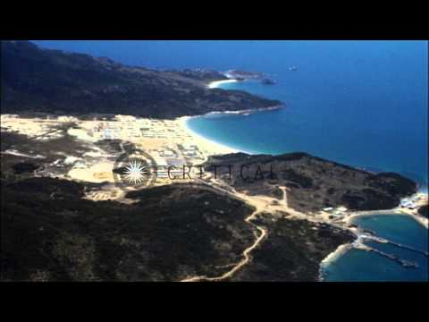 Aerial view of a Market Time boat base and surrounding area in Cam Ranh Bay, Viet...HD Stock Footage