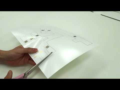Double-sided Printed Tactile Display with Electro Stimuli and