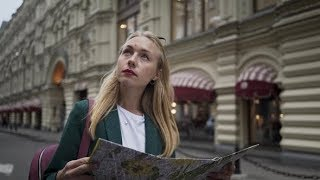 Blonde Tourist Looking at Map Walking Tverskaya Street in Moscow Russia Summer | Stock Footage -