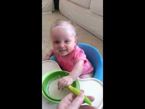 Camden wanting to feed herself now.