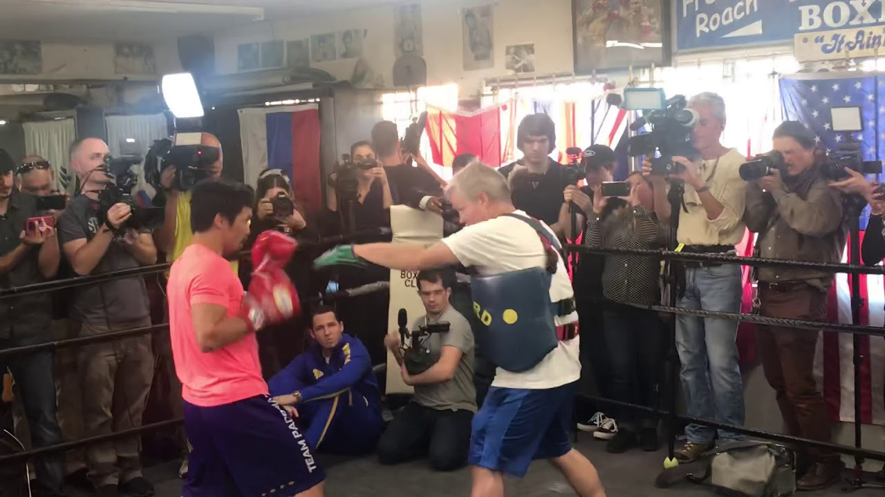 pacquiao-releasing-crazy-combination-on-trainer-freddie-roach