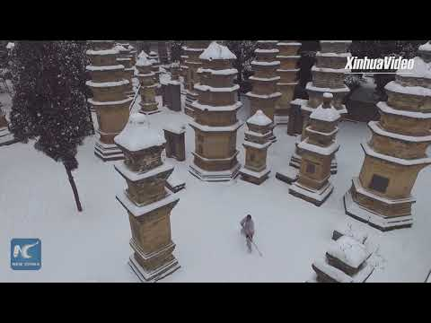 Serious kungfu in the snow! Watch rare display of martial arts at Shaolin Temple