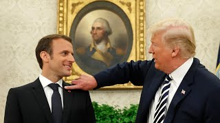 I'll get that little piece of dandruff off, says Trump as he flicks at Macron
