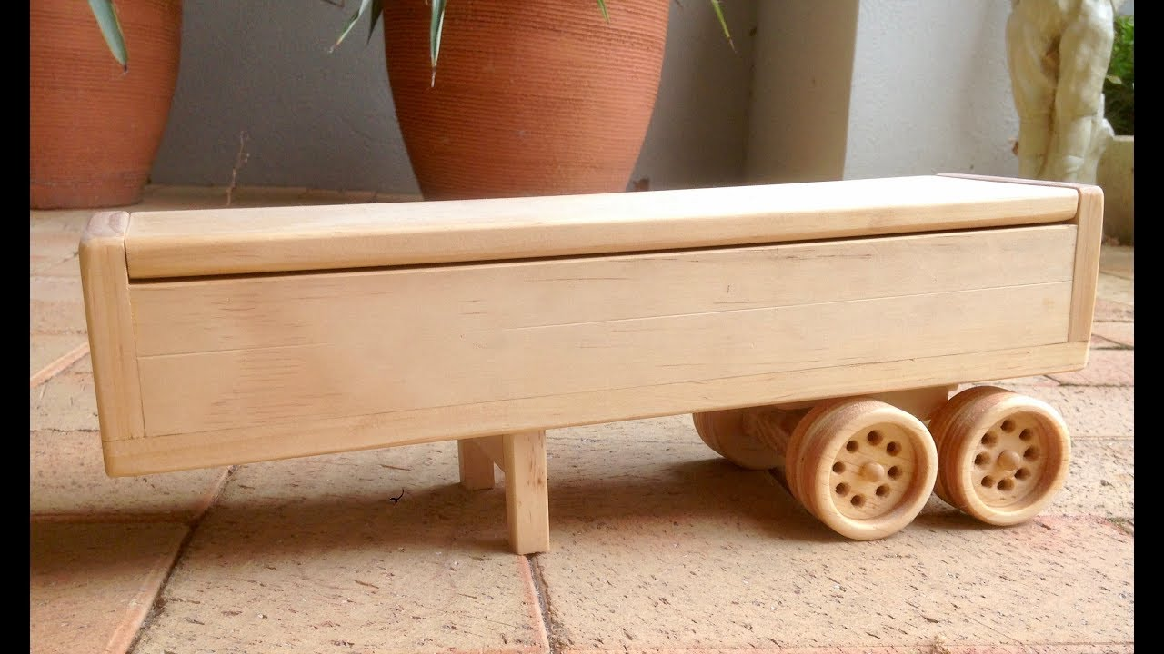 wooden toy box trailer with dual wheels