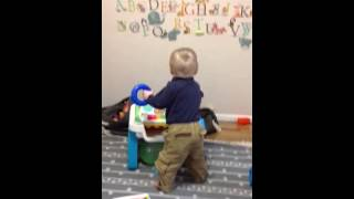 Baby Plays With Activity Table
