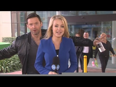 Hugh Jackman photobombs Ten News reporter Jessica Turner