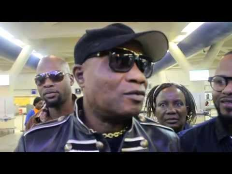 Koffie Olomide arriving at Harare International Airport