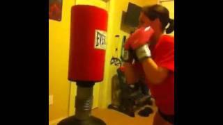 Teen girl kickboxing