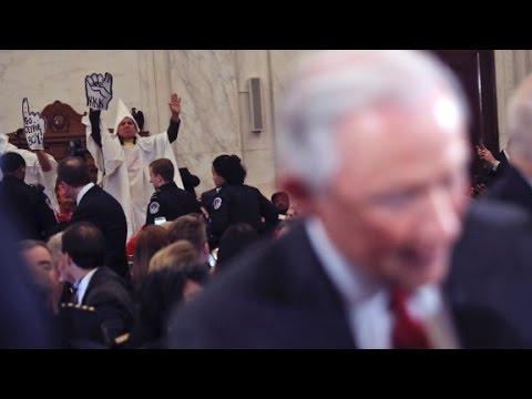 Protesters disrupt Sessions' AG hearing