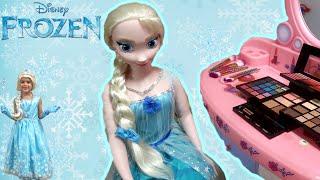 Sam plays with Disney Frozen Elsa Doll