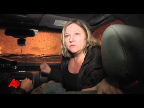 Raw Video: Snowstorm Traps Drivers All Night
