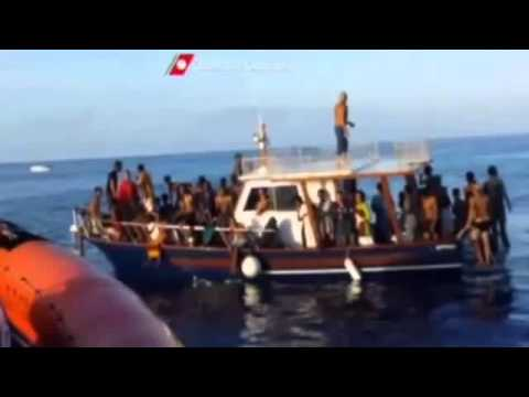 ltalian costugard  rescues migrants form water funy Video