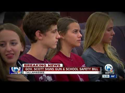 Gov. Rick Scott signs compromise gun control bill