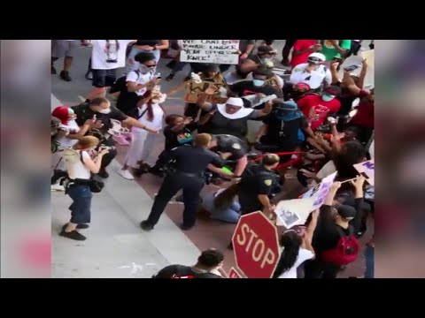Protester's video shows police officer pushing woman in Fort Lauderdale, crowd reacts