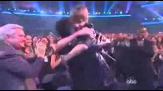 Justin Bieber winning Artist of the Year at the 2010 American Music Awards. He thanks Usher and gives him a HUGE hug. Usher did cry after Justin was given ...