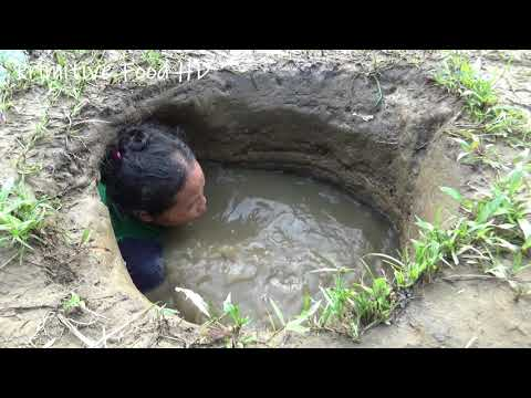Hand Fishing ! Survival Skills Catching Fish in Hole Mud Water   Build Fish Trap From Deep Hole