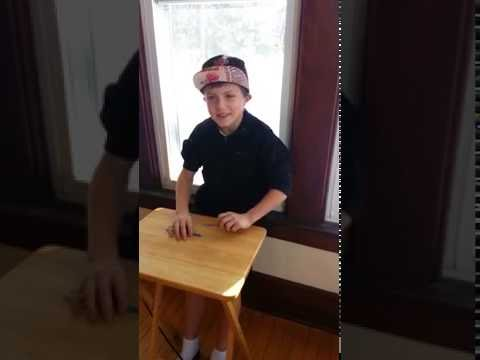 Little kid pen tapping like a boss