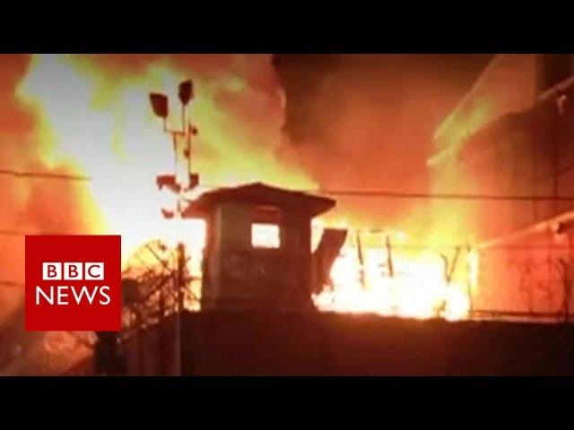 Inmates escape as prison burns - BBC News
