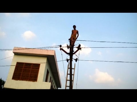 Drunkard climbs high-tension electric pole in northern India