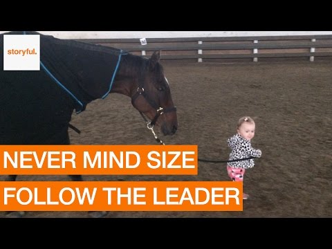 One-Year-Old Girl Leads Trusting Horse on Friendly Walk (Storyful, Kids)