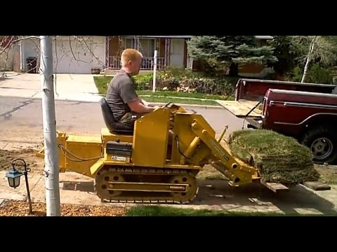 Mini Bull Dozer Magna Trac Junior moving 700lbs of sod with forks