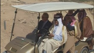 Prince Charles rides golden golf cart round Saudi historic town