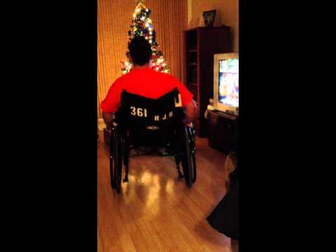 Simon the master of wheelchair wheelies