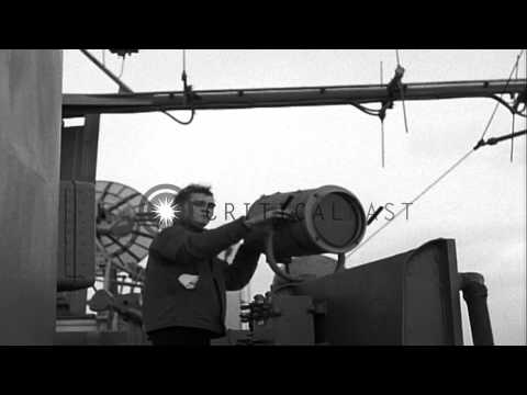 USS Des Moines signals to USS FDR, a quartermaster sends signals to USS Leyte and...HD Stock Footage