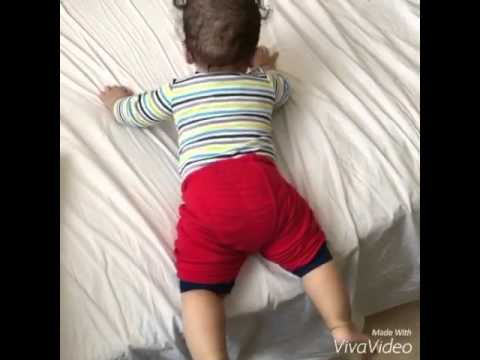 6 Months Old Baby Getting Down From The Bed