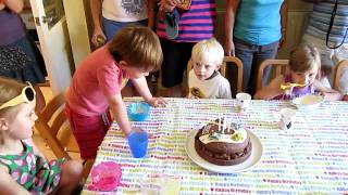 Louis looks at his bday cake age 4 Thumbnail