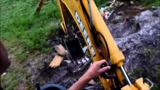 John Deere 310SG Backhoe Buring Trash