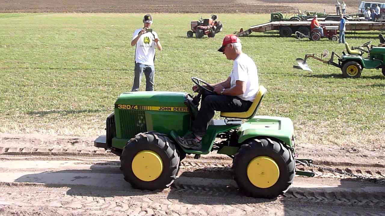 Articulating John Deere garden tractor Plow Days 2012 are Oct 5