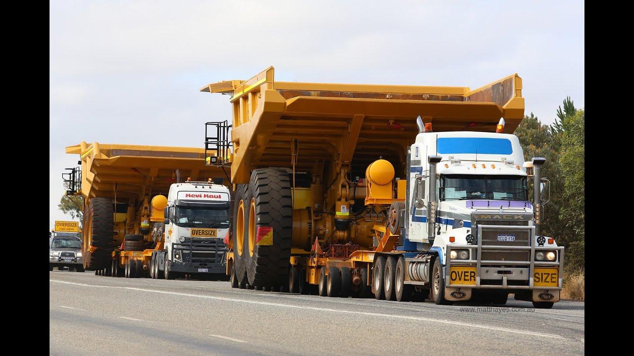 tri drive mack titan with a caterpillar 785c dump truck [ 1280 x 720 Pixel ]